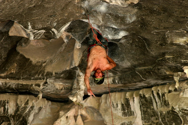 Chaz Ott climbing the steeps in the center of the Tecolote Cave...Photo by Curt MacNeill