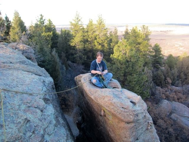 The top of the Banana Spire.<br> <br> Yeah, I made Wade give me a belay. I'm a wimp and out of shape. I didn't feel like having a misstep send me down the chimney or down the face. — at Castlewood Canyon State Park.