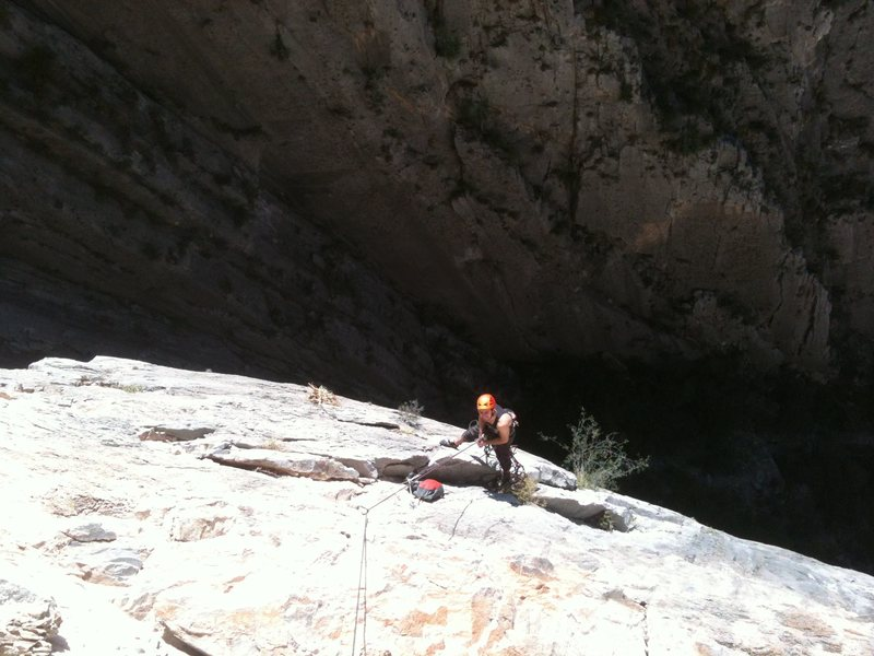 Dylan belaying at the start of the last 11b pitch