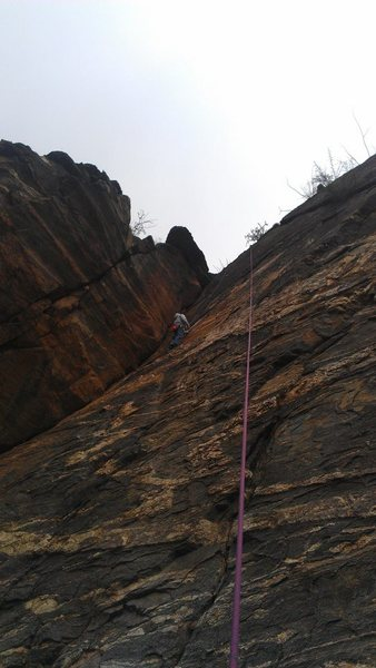 Rock Climbing Photo: a climber nearing the crux on dark riders