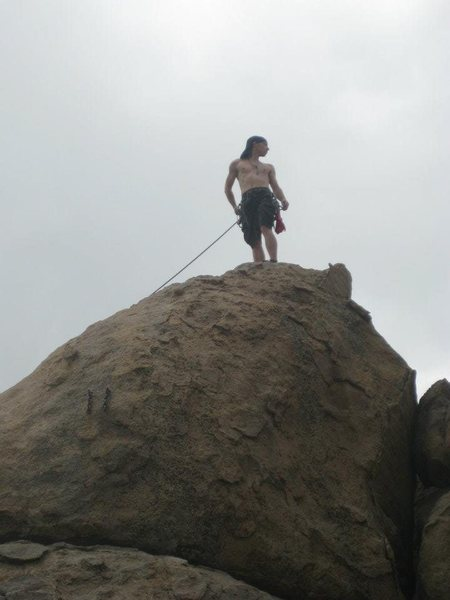 Rock Climbing Photo: The top out is a pretty heroic position.  Fun rout...
