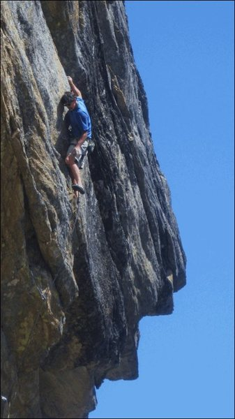 Climber on QED-MF, Big Science & Scary Math to the right of the climber