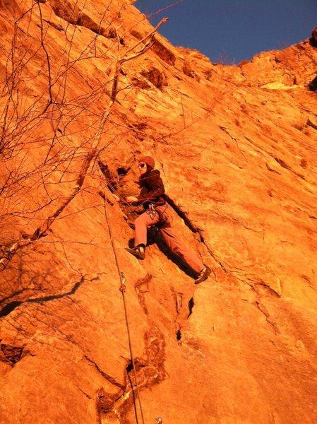 Sarah climbing Catwoman's Claw at sunset