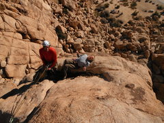 Rock Climbing Photo: Felix has a laugh while Fred takes a nap at the be...