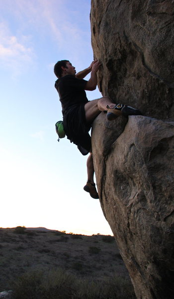 Up the easier route of the 20 point boulder 5.10