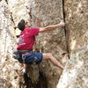 """A climber working up the crack near the start of """"Wonder Woman."""" Just jam your digits into that crack."""