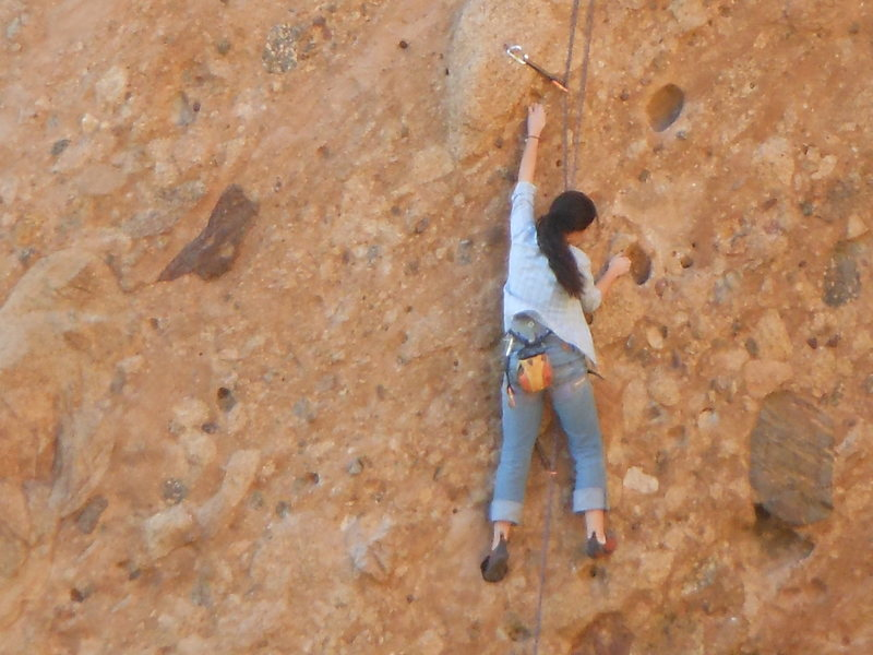 """Climber working the wonderful pockets on the """"Green Mile."""""""