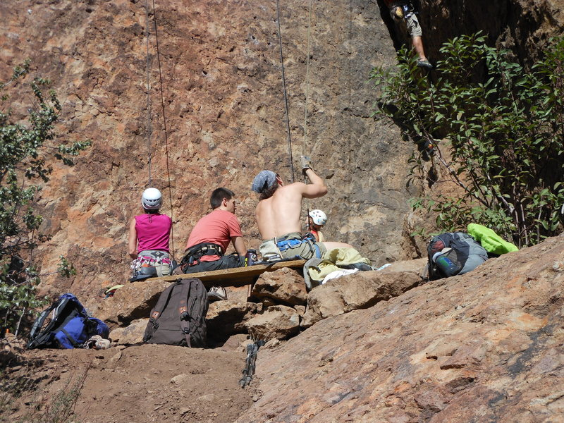 Climbers sharing the bench and enjoying the day at the Left Flank at Echo Cliffs.