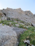 Rock Climbing Photo: Low on the route with a little vegetation, and som...