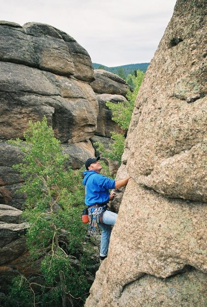Ashby Robertson on the first ascent of some 5.8 crack/corner near Buena Vista, Colorado<br> Sometime around 2002