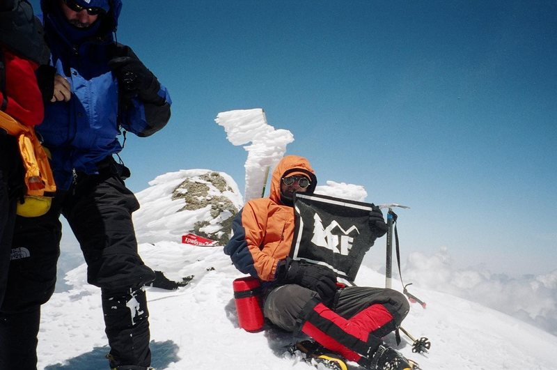 The summit of Mt. Elbrus with a banner thanking my local REI for the support.