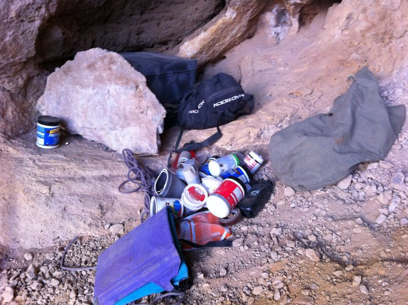 Trash left at the base of the cave.