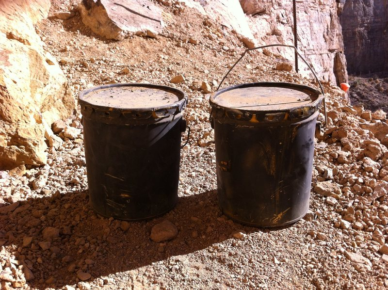 two buckets of glue left at the crag.