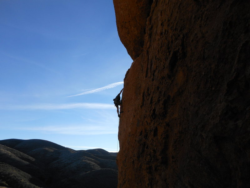"Climber high on the ""Green Mile"" late in the day at Texas Canyon."
