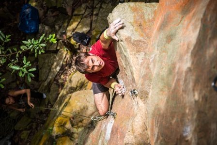 Karsten Delap climbing into the light on &quot;Acrophobia&quot; 5.10d<br>