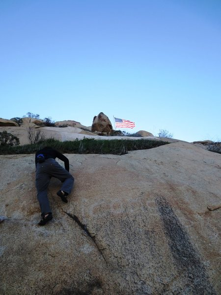 Rock Climbing Photo: Stepping up of the ledge onto the final slab.