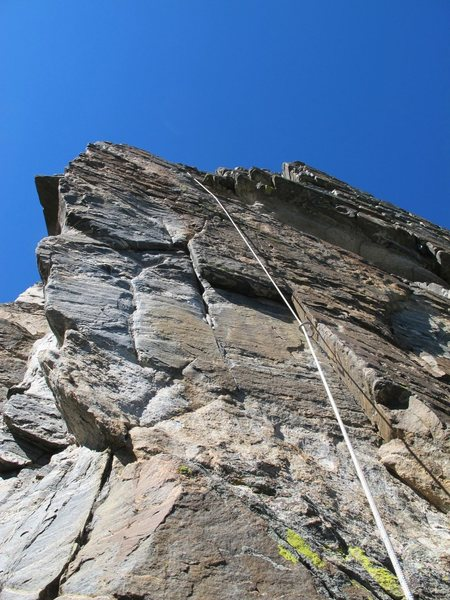 Crux pitch. Corner is optional belay. Go left at corner to arete, clipping bolt.