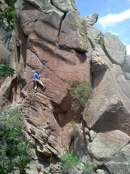 J.Snyder on Remudadero. Cubasco climbs widening crack behind tree to the right. The traverse is below giant boulder that creates the offwidth finish.