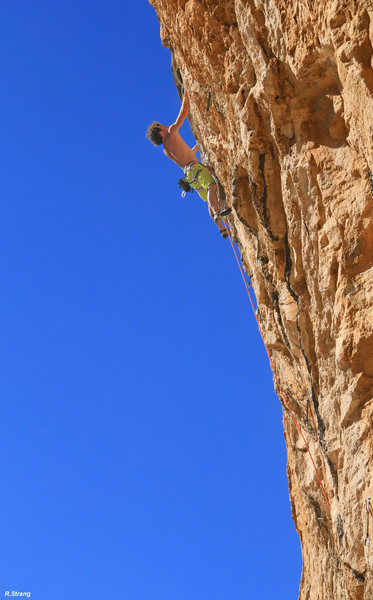 Cody climbing the 5.13 approach pitch into his project