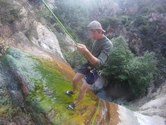 Repelling the first 100 ft. fall at Rubio canyon