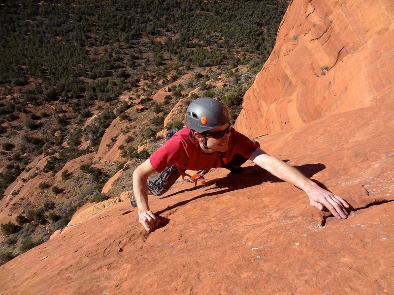 Nabbing the jug to finish the slab crux of P4. January 2013.