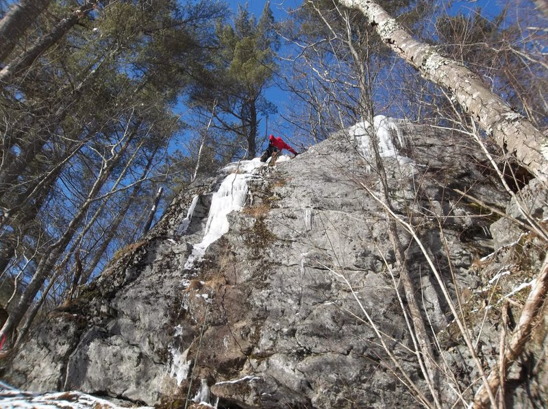 The top and right of Ryan are the rappel rings.