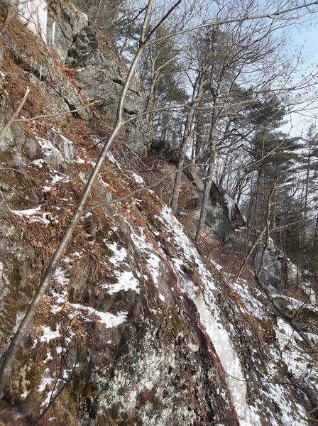 Belay could be at the block crack before the ice curtain. Camera angle is off, making it appear a little steeper than correct.