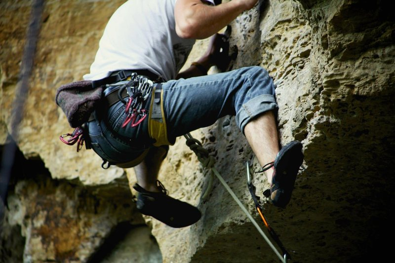 Rock Climbing Photo: high feet on small holds coming over the roof on a...