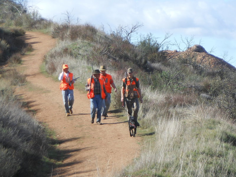 Hunters returning from shooting quail in the hills surrounding Texas Canyon.