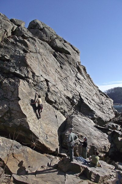 A View of the Purple Horse face with climber and audience.<br> <br> Climber Dave Rockwell, Photo John Ely