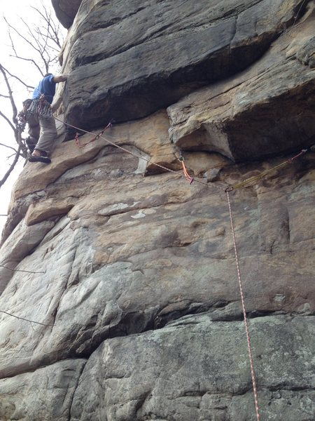 Joe moving around the first arete.