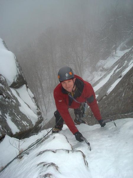 Rock Climbing Photo: Scott tops out of the first pitch on a foggy day.