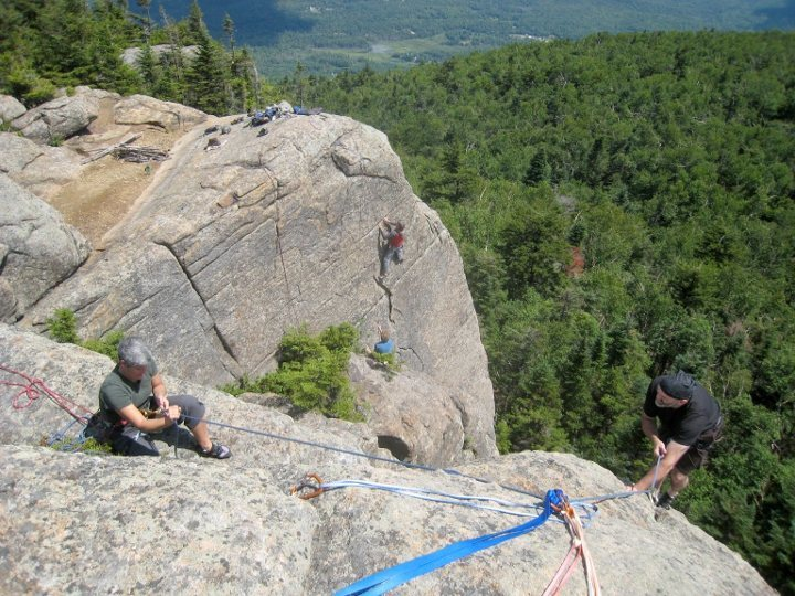 Jeff and Laurel in the foreground on <em>Rock of Ages</em>@SEMICOLON@ Jay climbs <em>Toiling Men</em> in the background.