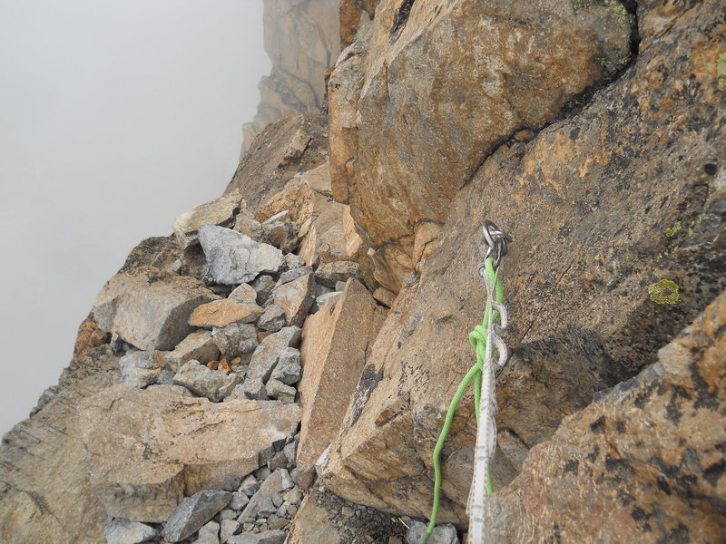 RAPPEL @POUND@2<br> Just one bolt for a very steep rap. The following four raps are fairly easy to find and all single bolt.
