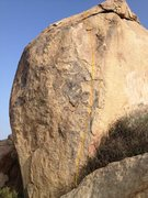Follow good edges and pinches up the right arete of the south face.