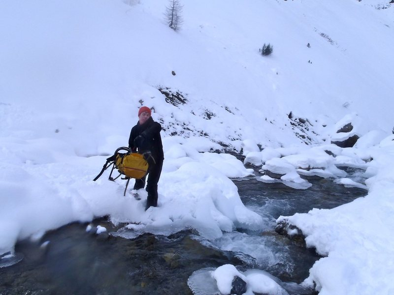 This should end well.... navigating stream crossing in ski boots