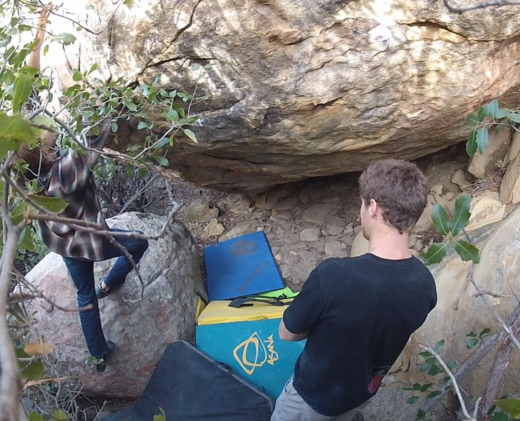 Me (on the left) scoping out the topout for Oddysee, with Thomas standing in front of the main holds for 'Highway' just prior the first ascents.<br> <br> Both climbs start at the very bottom of the overhang.