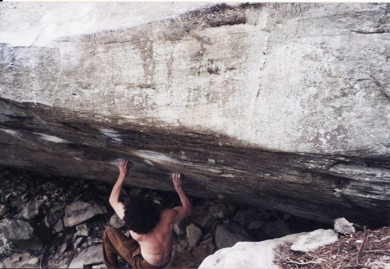 Pulling off the ground ready to do the crux snatch on Two Pop V9 Lost Cove, North Carolina in 2003.  This was taken the day I sent.  There are no feet for this move it is completely campus and also very difficult not to dab on the rock to the right.  I had already injured my right ring ringer A2 pulley mainly due to trying this problem so many times.  The send took no less than 80-100 tries over 3 or 4 days on 2 trips.  It is the most attempts I have put into a single problem.