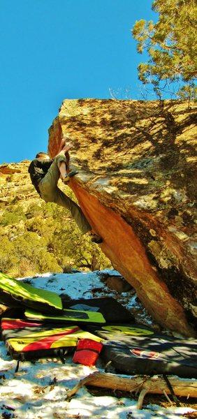 Rock Climbing Photo: Arien working the crux of Draconian Binger.