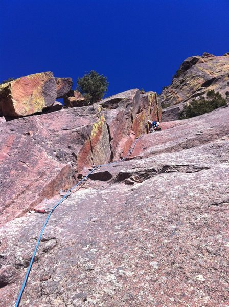 Austin leading up P1 of Perversion. Mickey Mouse Wall. About to launch into and then send the crux.