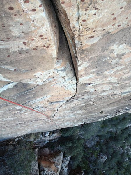 Looking down on the lower 2/3 of the route from the optional belay ledge. Splitter fingers!