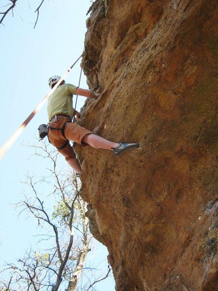 Climber pulling thru crux on Unprepared 11-.