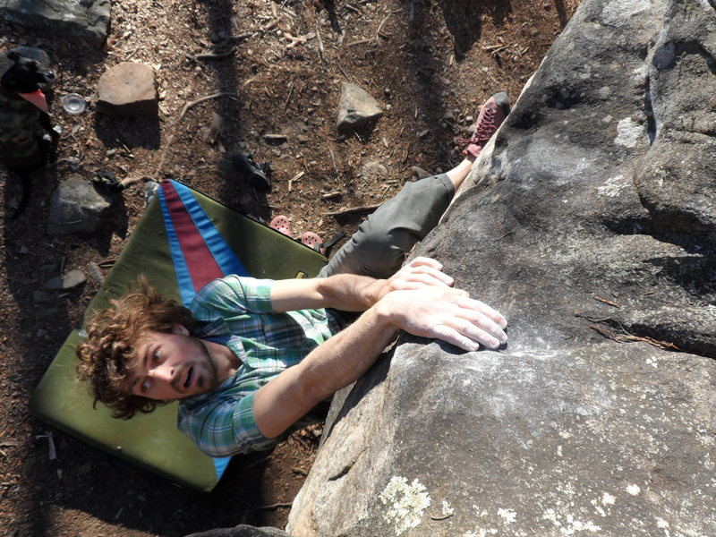 Topping out blockhead on the Tao boulder.