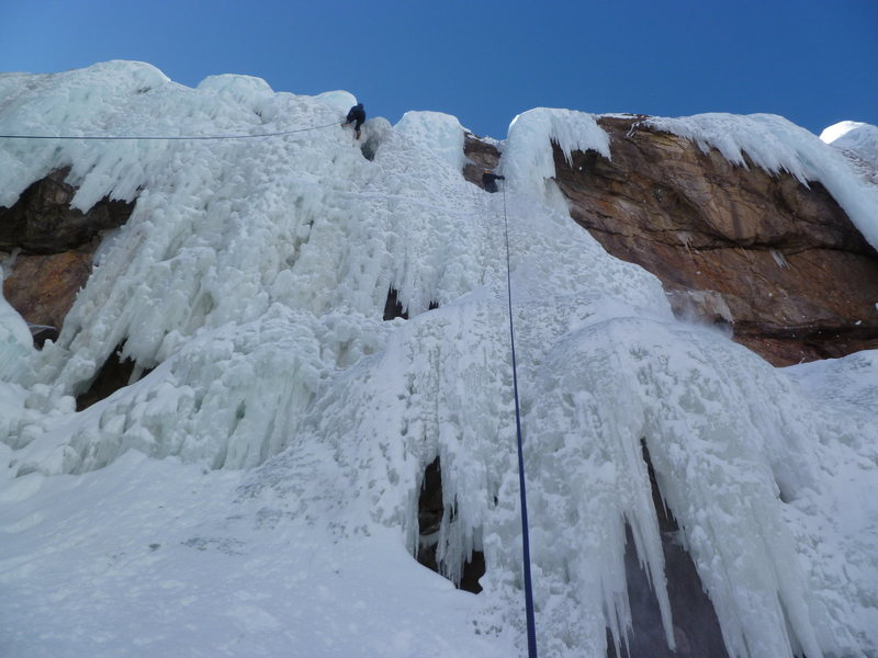 The climber on the right is near the top of the route.