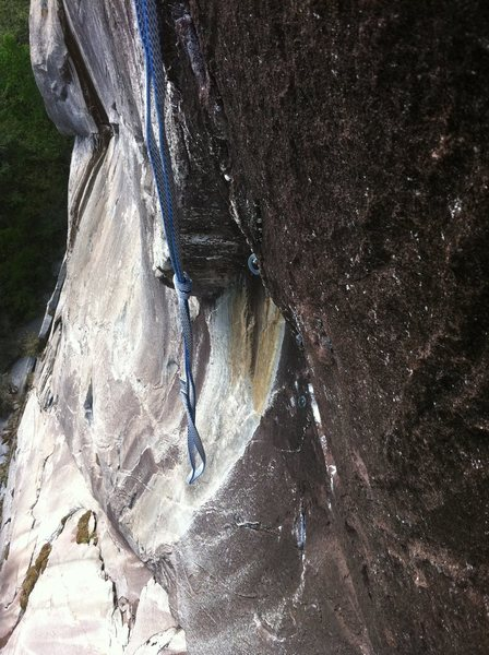 Photo showing steepness at start of P2 boulder problem. This section of the crux v7 boulder problem is a deadpoint to get established in some overhanging tips liebacking that leads to the crux long reach at the top of the shallow corner.
