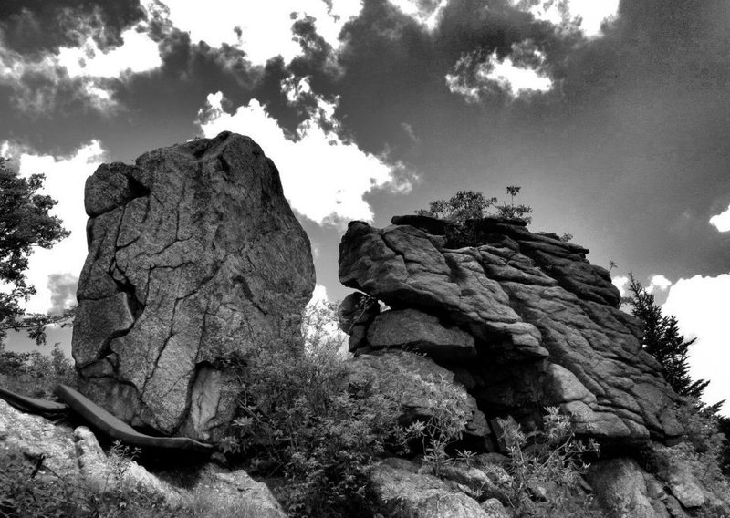 The left boulder is the Puzzler boulder. The right smooth face (on the right most section of the face) is Jigsaw.