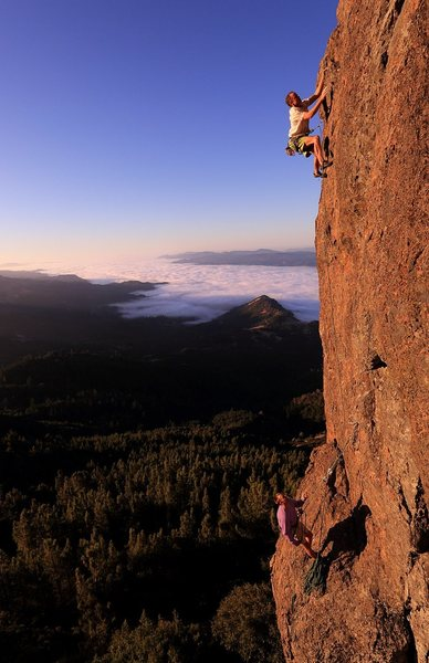 Eric Berghorn and Jerry Dodrill on upper face, Smash n Grab 5.11c/d.<br> Photo Credit: Jim Thornburg