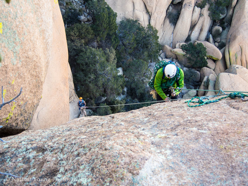 Rap station from the top.  You can make it all the way down with two ropes, no middle belay necessary.  <br> <br> If you are just a two person party, only take a single rope and do the two rap stations, much lighter and the rope management on a single with this route is way easier.