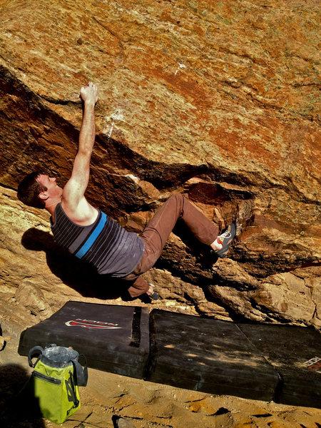 Rock Climbing Photo: Slapping around the roof.