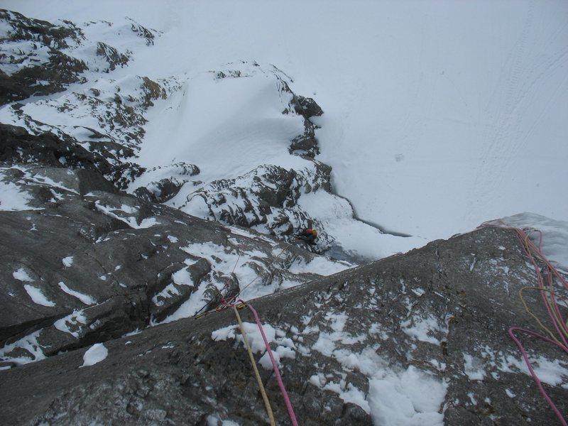 Paul Gardner climbing the rock pillar at the start.